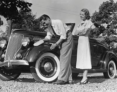 Couple Polishing Car Art Print by George Marks