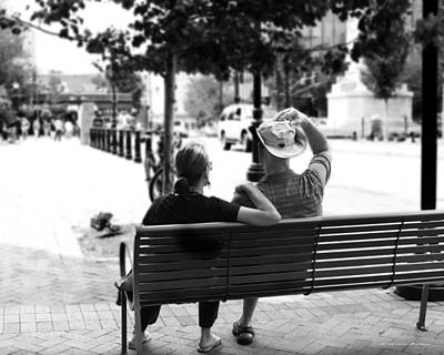 Photograph - Couple Resting On A Downtown Bench On A Windy Day by Gray  Artus