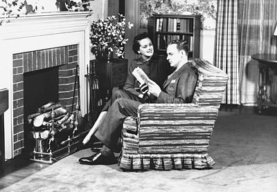 Couple Sitting On Armchair In Front Of Fireplace, (b&w) Art Print by George Marks