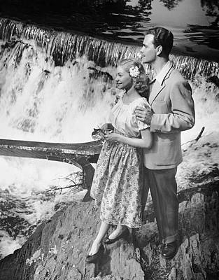 Couple Standing Near Waterfall Art Print by George Marks