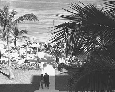 Couple Walking In Path Towards Beach, (b&w), Elevated View Art Print by George Marks