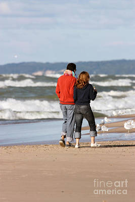 Waves Photograph - Couple Walking On Beach In New Buffalo Michigan by Christopher Purcell