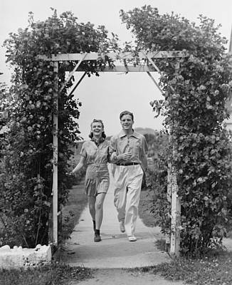 Couple Walking On Footpath Towards Rose Covered Pergola, (b&w) Art Print by George Marks