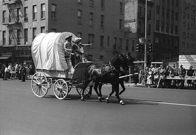 Covered Wagon On Street During Parade Art Print by George Marks