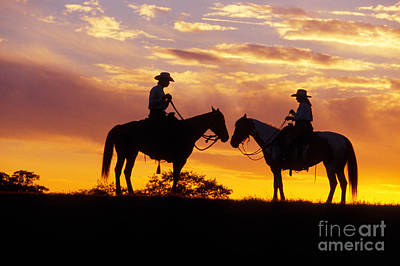 Photograph - Cowboy And Cowgirl by Ron Sanford and Photo Researchers