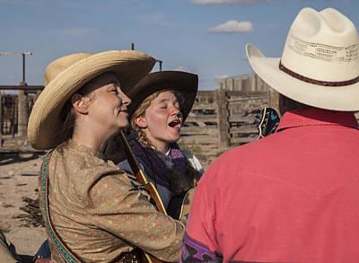 Cowgirl Serenading The Cowboys Art Print by Ralph Brannan