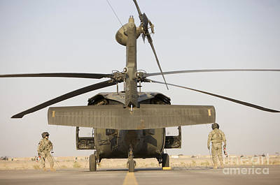 Crew Chiefs Stand Beside Their Uh-60l Art Print by Terry Moore