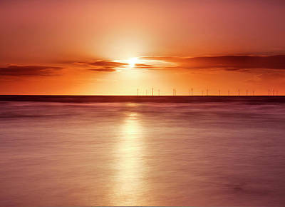 Clouds Over Sea Photograph - Crosby Beach In Sunset by Ian Moran