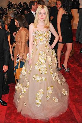 Dakota Fanning Wearing A Dress Print by Everett