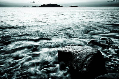 Dark Waves Swirling Around A Rock In The Caribbean In Black And White Art Print