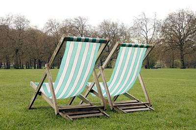 Reclining Chairs Photograph - Deck Chairs by Johnny Greig