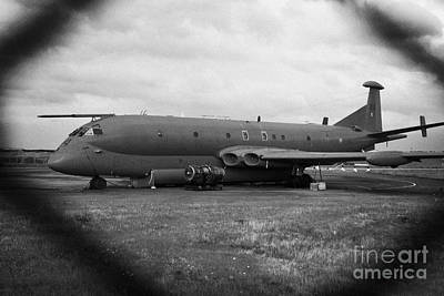 Raf Photograph - decommissioned RAF nimrod aircraft through the fence at former RAF Kinloss airbase scotland uk by Joe Fox