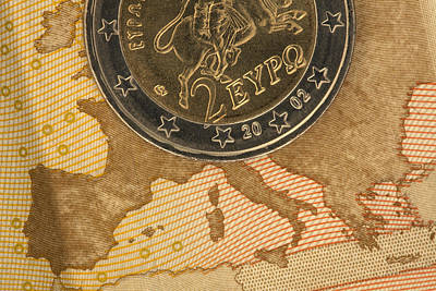 On Paper Photograph - Detail Of A Fifty Euro Banknote With A Two Euro Coin On Top Of It by Larry Washburn