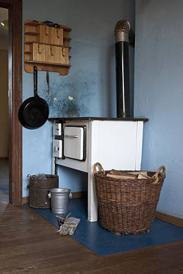 Old Wood Burning Stove Photograph - Detail Of An Old-fashioned Kitchen by Halfdark