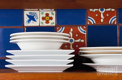 Dishes In Front Of Colorful Tile Art Print by Thom Gourley/Flatbread Images, LLC