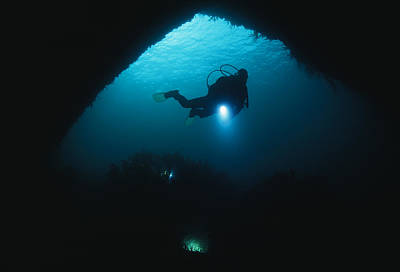 Diver Exploring An Underwater Cave Art Print by Brian J. Skerry