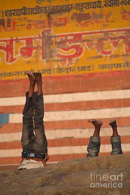 Cremation Ghat Photograph - Doing Yoga On The Ghats At Varanasi by Serena Bowles
