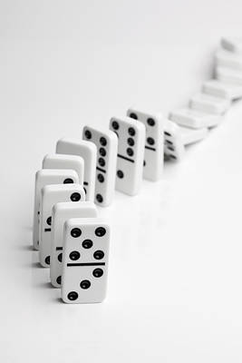 Dominoes Falling Over In A Chain Reaction Art Print by Larry Washburn