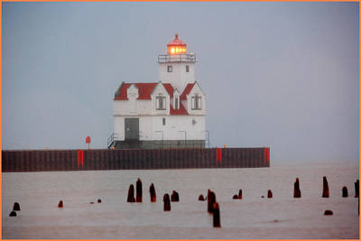 Photograph - Door County Lighthouse On The Bay by Fuad Azmat