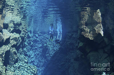 Dry Suit Divers Entering The Gin Clear Art Print by Mathieu Meur