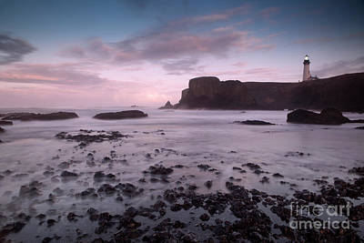 Turbulent Skies Photograph - Dusk At Yaquina Head Lighthouse by Keith Kapple