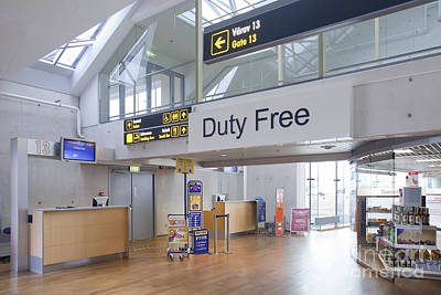 Airport Concourse Photograph - Duty Free Shop At An Airport by Jaak Nilson