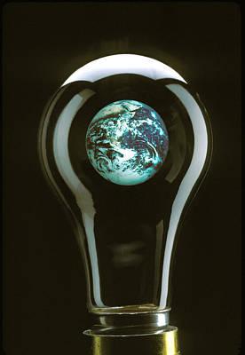 Earth In Light Bulb  Art Print by Garry Gay