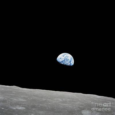 Earth Rising Above The Lunar Horizon Art Print