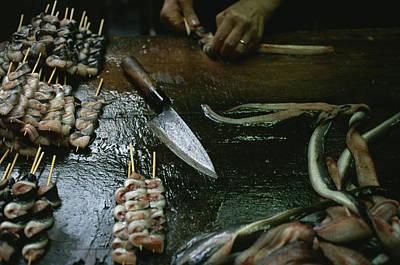 Eel Is Skewered And Sold At A Market Art Print by Justin Guariglia
