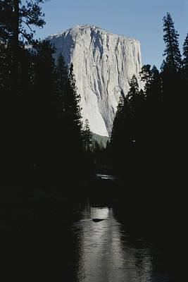 El Capitan Soars Above The Merced River Art Print by Marc Moritsch
