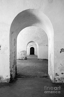 Photograph - El Morro Fort Barracks Arched Doorways Vertical San Juan Puerto Rico Prints Black And White by Shawn O'Brien