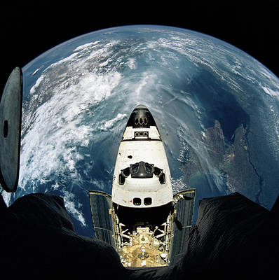 Space Ships Photograph - Elevated View Of A Spacecraft Orbiting Over The Earth by Stockbyte