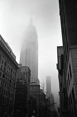 Empire State Building In Fog Print by Adam Garelick