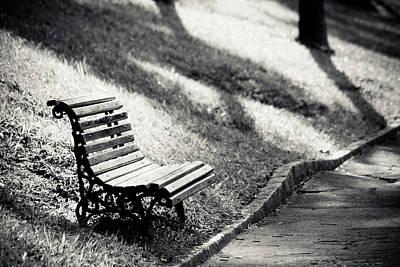 Empty Park Bench On Edge Art Print by (c) Conrado Tramontini