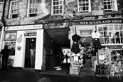 Royal Mile Photograph - Entrance To Milnes Court Between Tourist Gift Shops On The Lawnmarket Royal Mile Edinburgh Scotland by Joe Fox