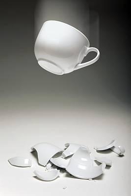 Entropy Shown By Broken Cup Art Print by Victor De Schwanberg