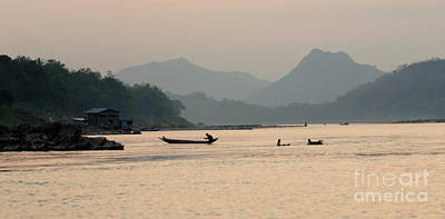 Boat Along The River Photograph - Evening On The Mekong by Bob Christopher
