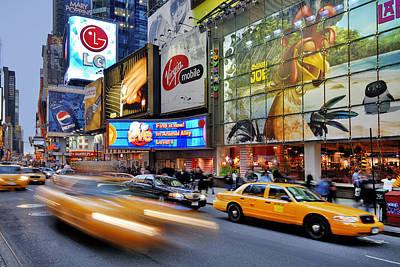Evening Traffic At Times Square Art Print by Izzet Keribar