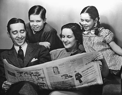 Family Reading Newspaper Art Print by George Marks
