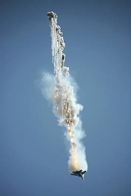 Sukhoi Photograph - Fighter Aircraft Dispensing Flares by Ria Novosti