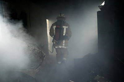 Crime Fighter Photograph - Fire Fighter In A Burnt House by Michael Donne