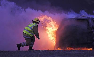 Firefighter Tackling A Burning Car Art Print