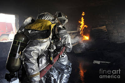 Firefighters Extinguish A Fire Art Print