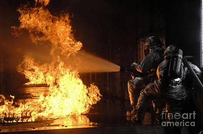 Firefighters Extinguish A Simulated Art Print