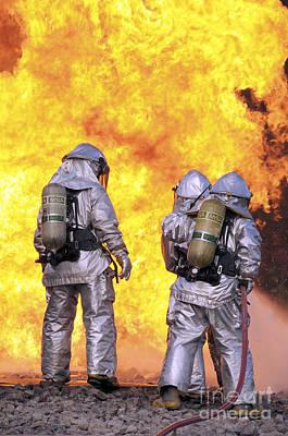 Firefighters Extinguish An Aircraft Art Print by Stocktrek Images
