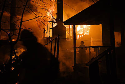 Firefighters Spray Down A Burning House Art Print by Mark Thiessen