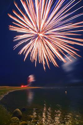 Brilliant Fireworks Photograph - Fireworks Over A Body Of Water by Carson Ganci