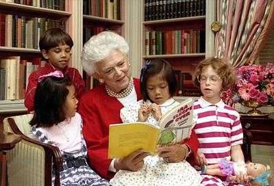 First Lady Barbara Bush Reads Art Print by Everett