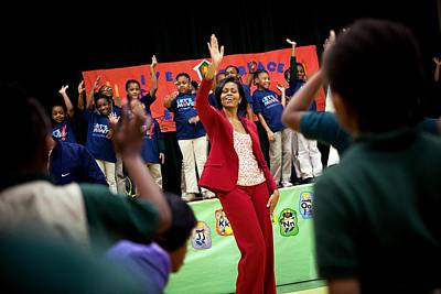Advocacy Photograph - First Lady Michelle Obama Exercises by Everett