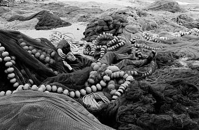 Art Print featuring the photograph Fisherman Sleeping On A Huge Array Of Nets by Tom Wurl